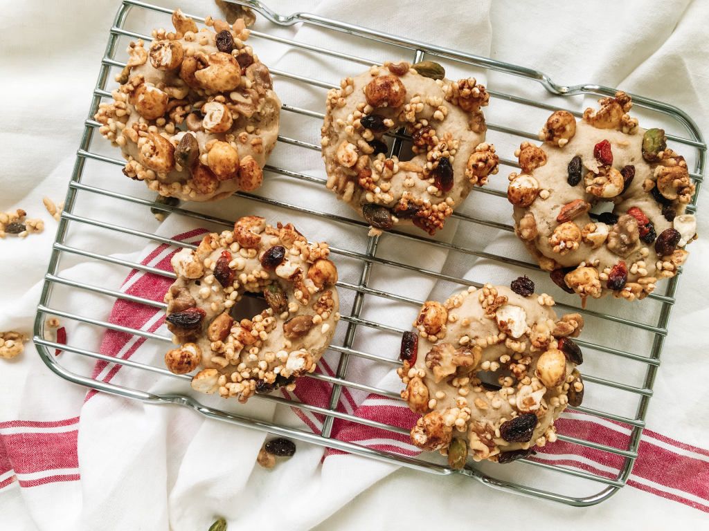 Baked donuts with granola on rack and cloth