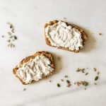 Seedy pumkin bread with cracked pepper and goats cheese, sliced and topped with cream cheese