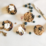 Blueberry baked oatmeal cups with greek yogurt on marble with knife FEATURE