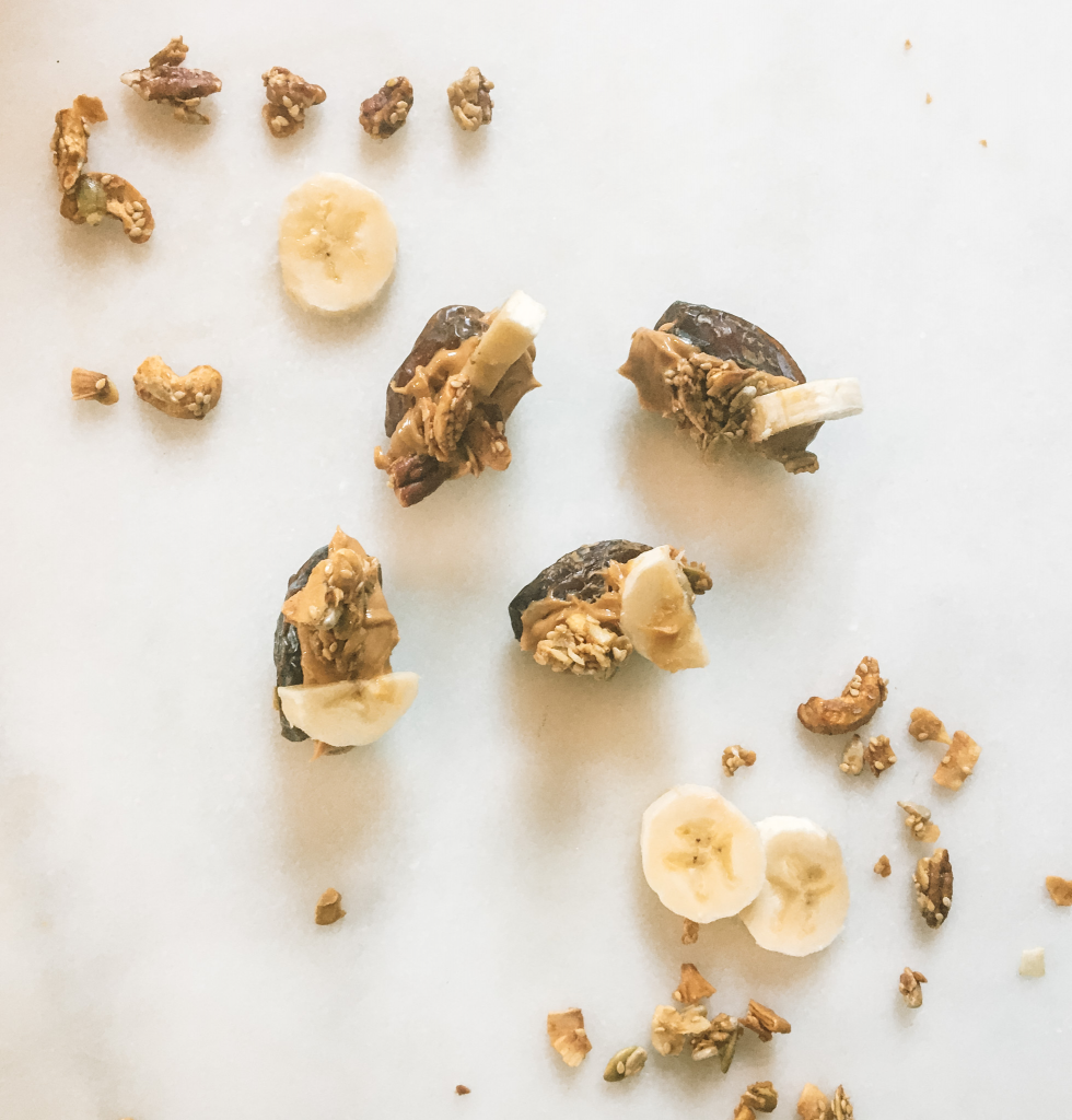 Peanut butter stuffed dates with banana and granola