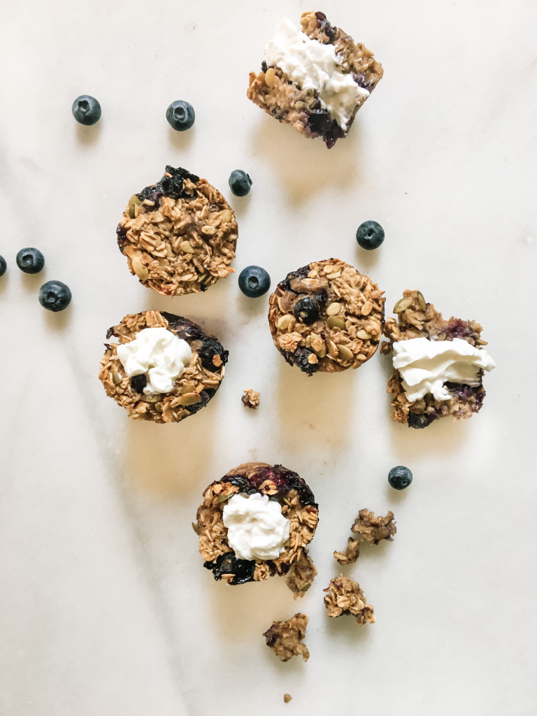 Blueberry baked oatmeal cups with greek yogurt on marble