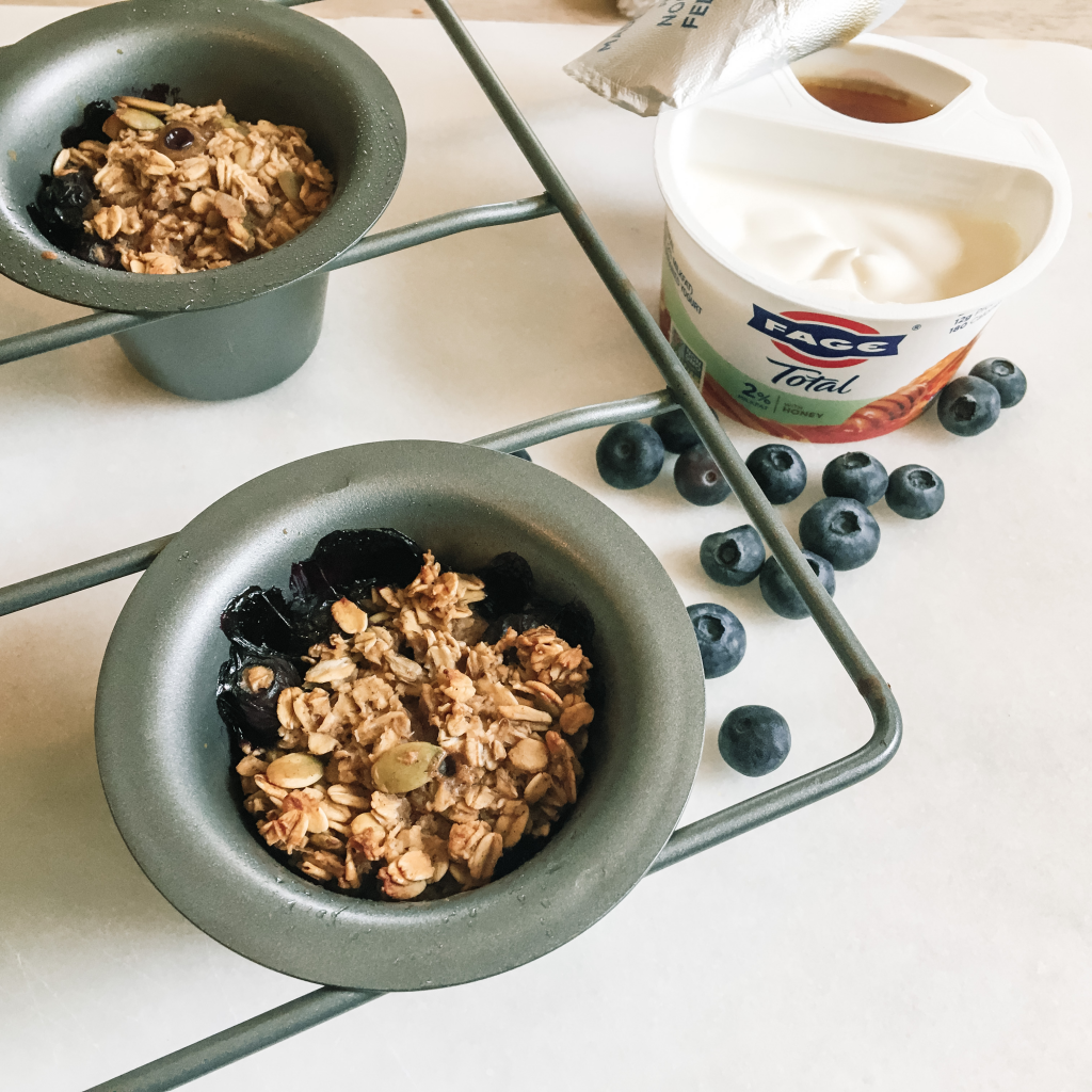 Blueberry baked oatmeal cups in pan with yogurt container