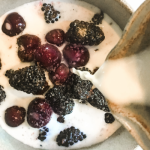 Cherries and blackberries with vanilla cream poured in feature 2
