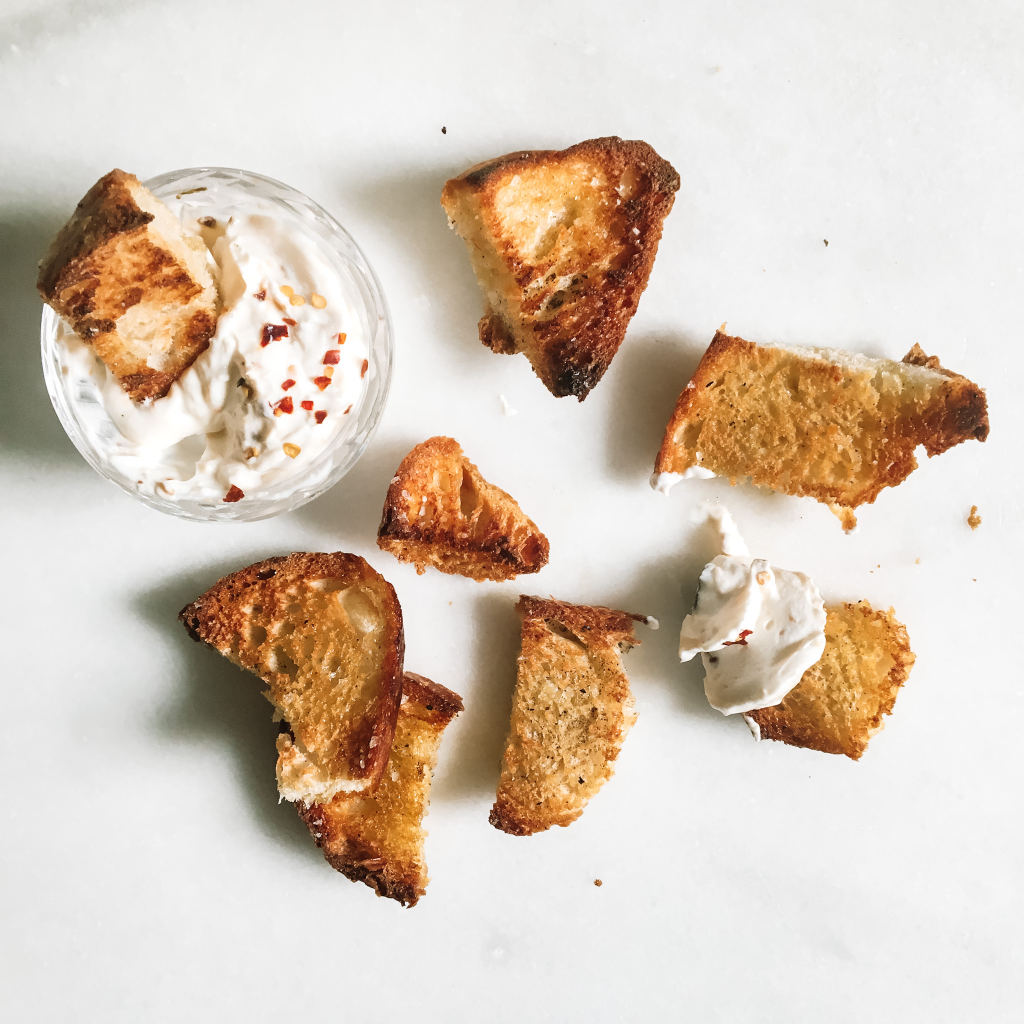 Apricot chili goat cheese dip with giant sourdough croutons