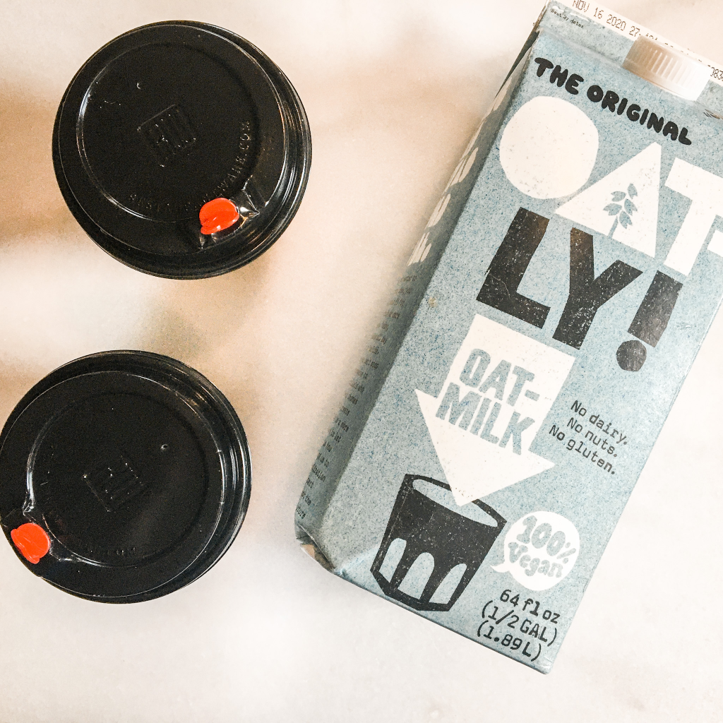 Oat milk mocha in togo cups with oatly milk